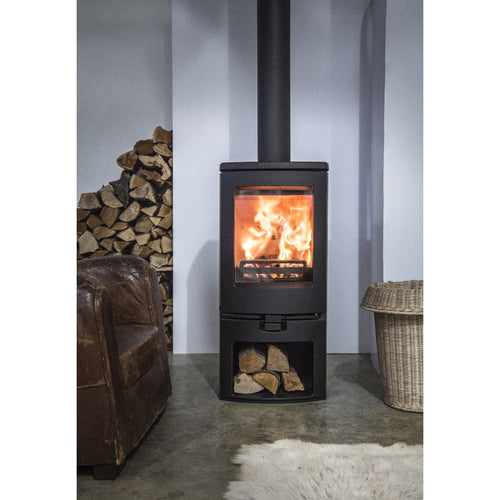 Charnwood Arc 7 Freestanding Wood Burner with Log Storage by Leather Chair