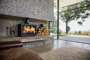 Bay BX Eco Design Wood Burning Fire in Living Room overlooking Mountains Sea Golf Resort Brown Leather Interior