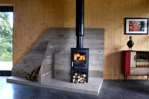 Charnwood C Six Freestanding Wood Burning Stove in Stone Fireplace Log Storage Cabin