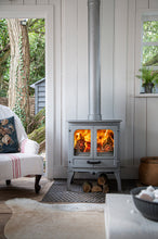 Load image into Gallery viewer, Charnwood All New Island I Woodburning Stove Double Door Living Room on Grey Wood Wall Pewter