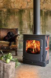 Charnwood Cove 2 Wood Burning Stove with Dog on Antique Chair