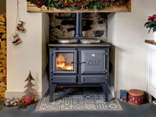 Load image into Gallery viewer, Esse Ironheart Seasonal Festive Christmas Display in Kitchen Wood Burning Cooking