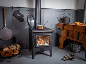 Esse Warmheart Pan Cooking Dish on Stove Wood Burning Stove in Country Kitchen Pizza Spade Wood Logs Country Cottage