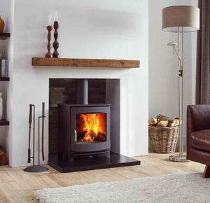 Dik Geurts Ivor Low EA Multi Burning Wood Stove Freestanding in Living Room Log Storage Leather Couch Wooden Mantlepiece