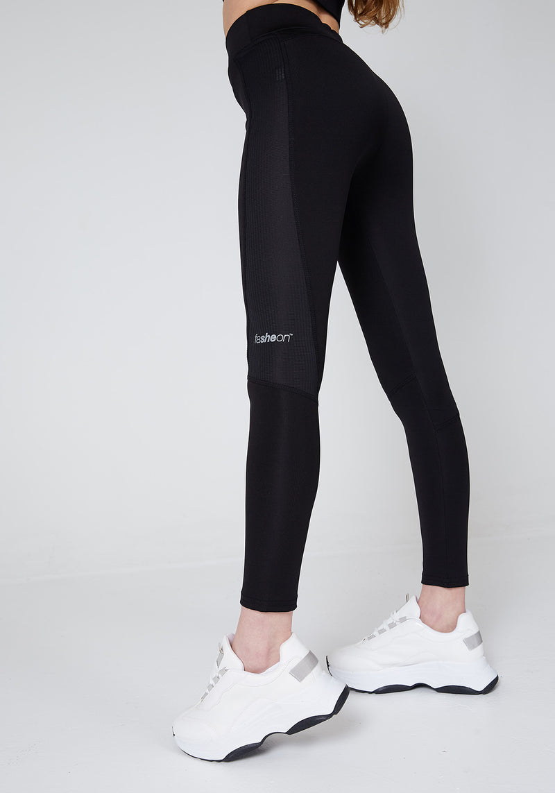 Side Look of Black Slogan Sports Leggings with Seam Detail