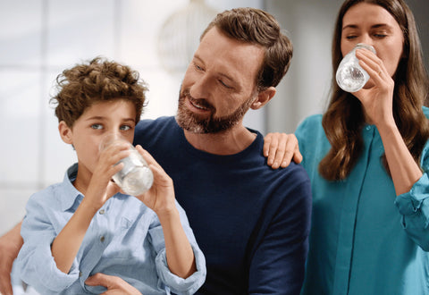 family drinking water