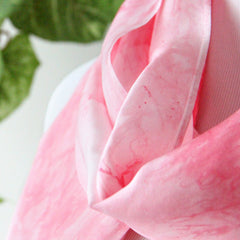 close up of pink silk scarf