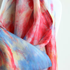 close up of pink, blue & yellow silk scarf