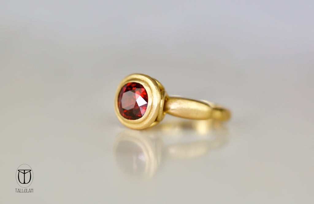 Handcrafted spessartite ring in 22 ct gold