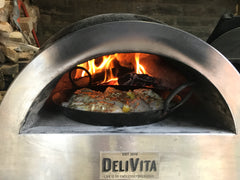 Cooking chicken in the DeliVita wood-fired oven