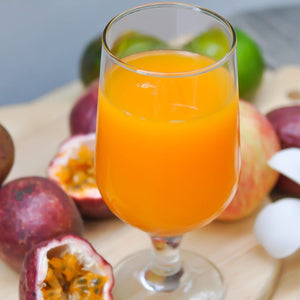 Carrot and passion fruit juice in wine glass