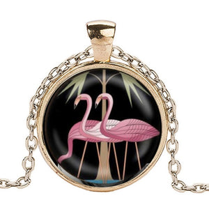 Gold finish pendant with pink flamingo