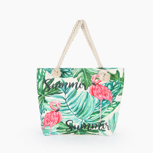 Flamingo and green leaves tote bag