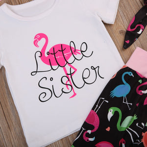 White t-shirt with pink flamingo print