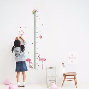 Girl using measuring wall chart