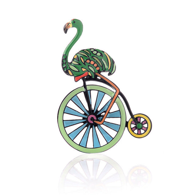 Green flamingo and wheel brooch