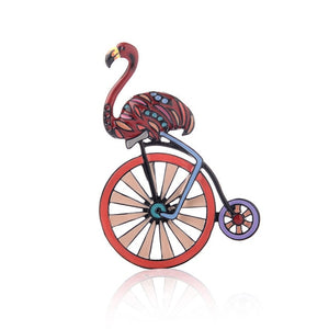 Pink flamingo and wheel brooch