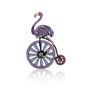 Purple flamingo and wheel brooch