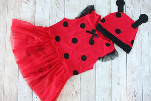 red romper with black polka dots that looks like a ladybug with a matching hat with antenas