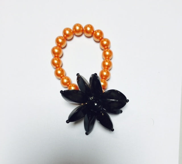 B0128B  BRACELET ORANGE/BLK FLOWER