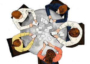 image of a family sitting around the table sorting The Family and Business Values Cards