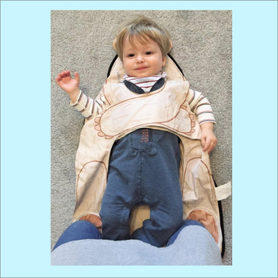 Mom review image of happy toddler at nappy changing time with mom kneeling on the kneepads to stop rolling over
