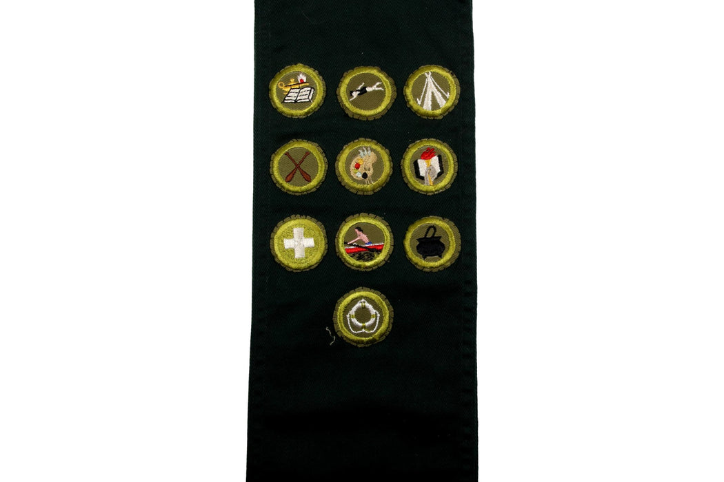 Merit Badge Sash 1950s with 10 Kahki Crimped Merit Badges on Explorer Green