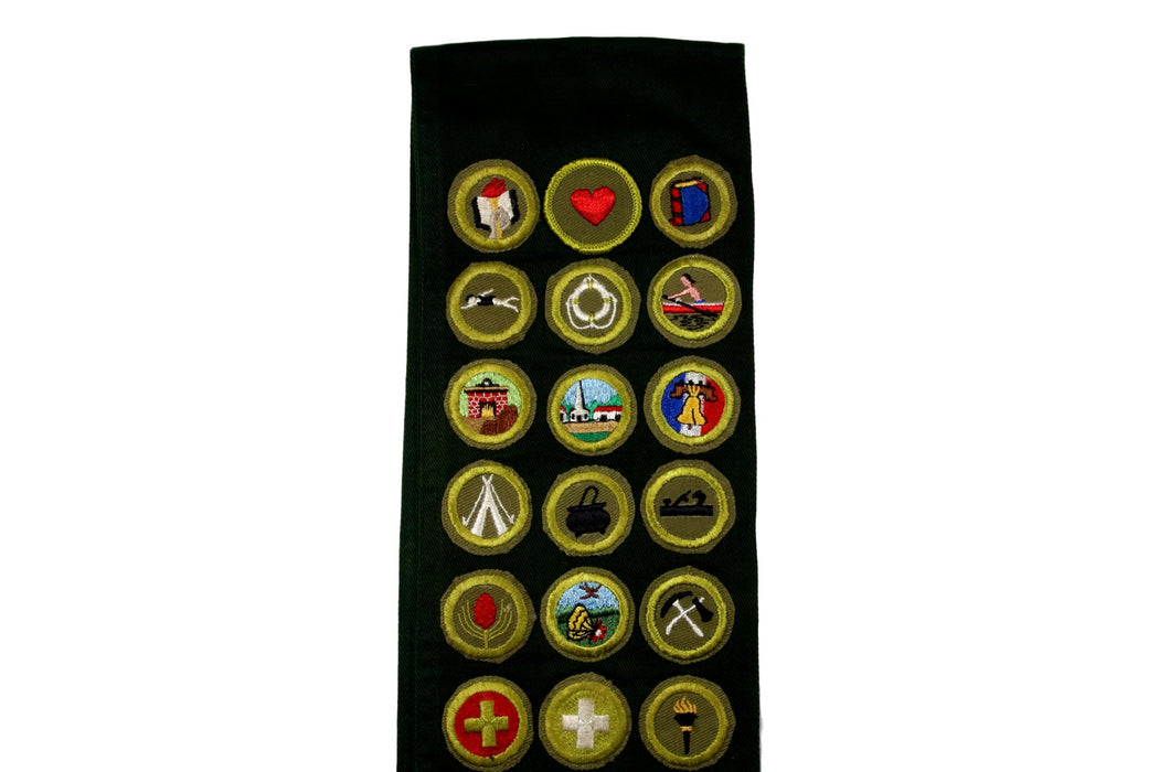 Merit Badge Sash 1950s with 1 Rolled Edge Till and 28 Kahki Crimped Merit Badges on Explorer Green