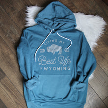Living My Best Life in Wyoming Hooded Sweatshirt in Heather Teal