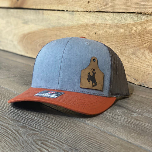 Wyoming Cowboys Leather Cow Tag Patch Heather Grey Dark Orange Snapback Hat
