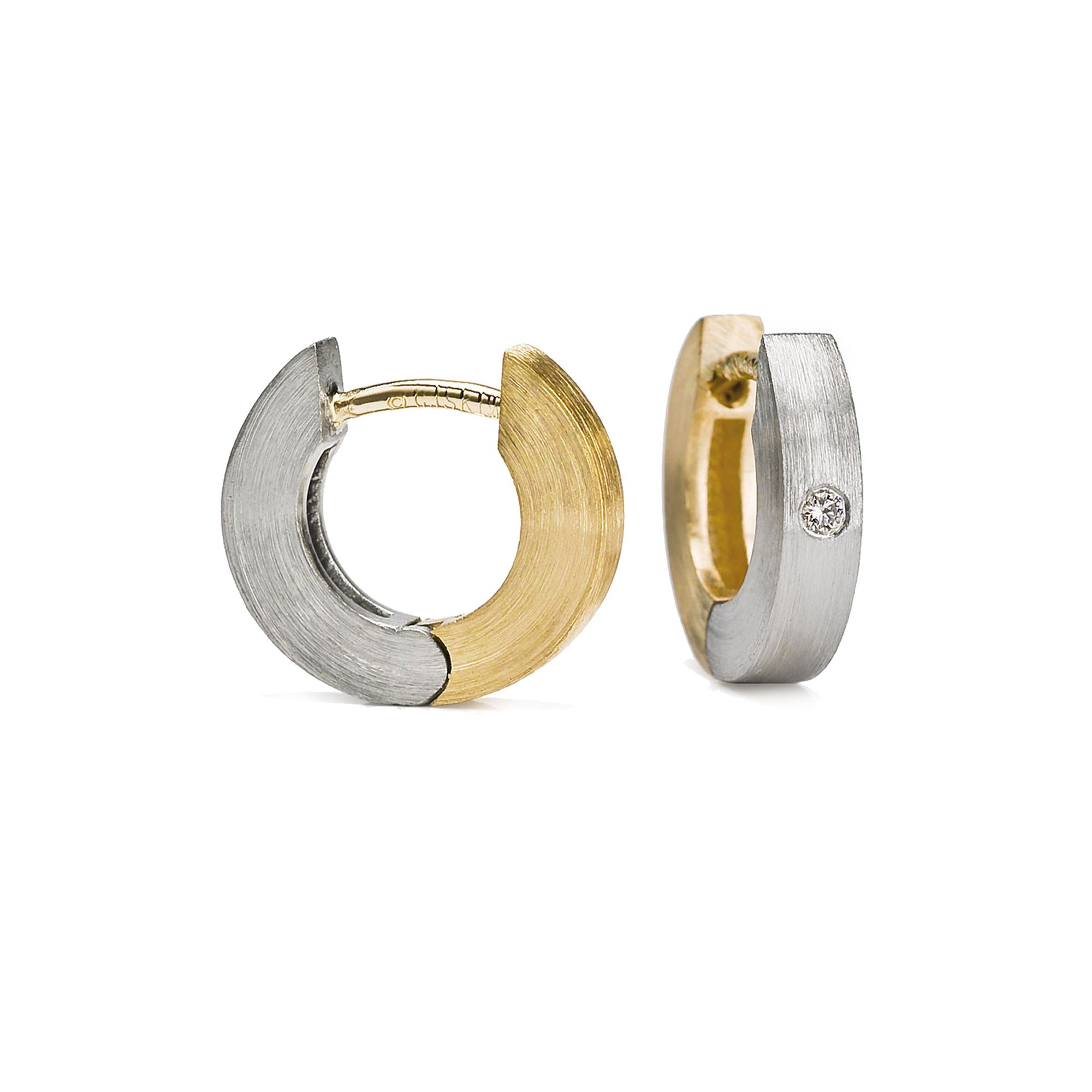 These flat profile hinged hoops earrings are 18k yellow gold and palladium with small burnish set white diamonds set in the palladium.