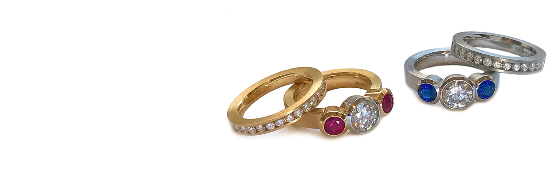 3 stone modern engagement rings with channel set wedding bands in 18k with rubies or Pt. with blue sapphires, both with diamonds.