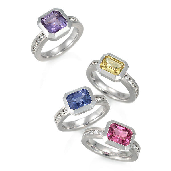 4 Rings in pastel color gems bezel set in white metal with small round diamonds in the shanks.