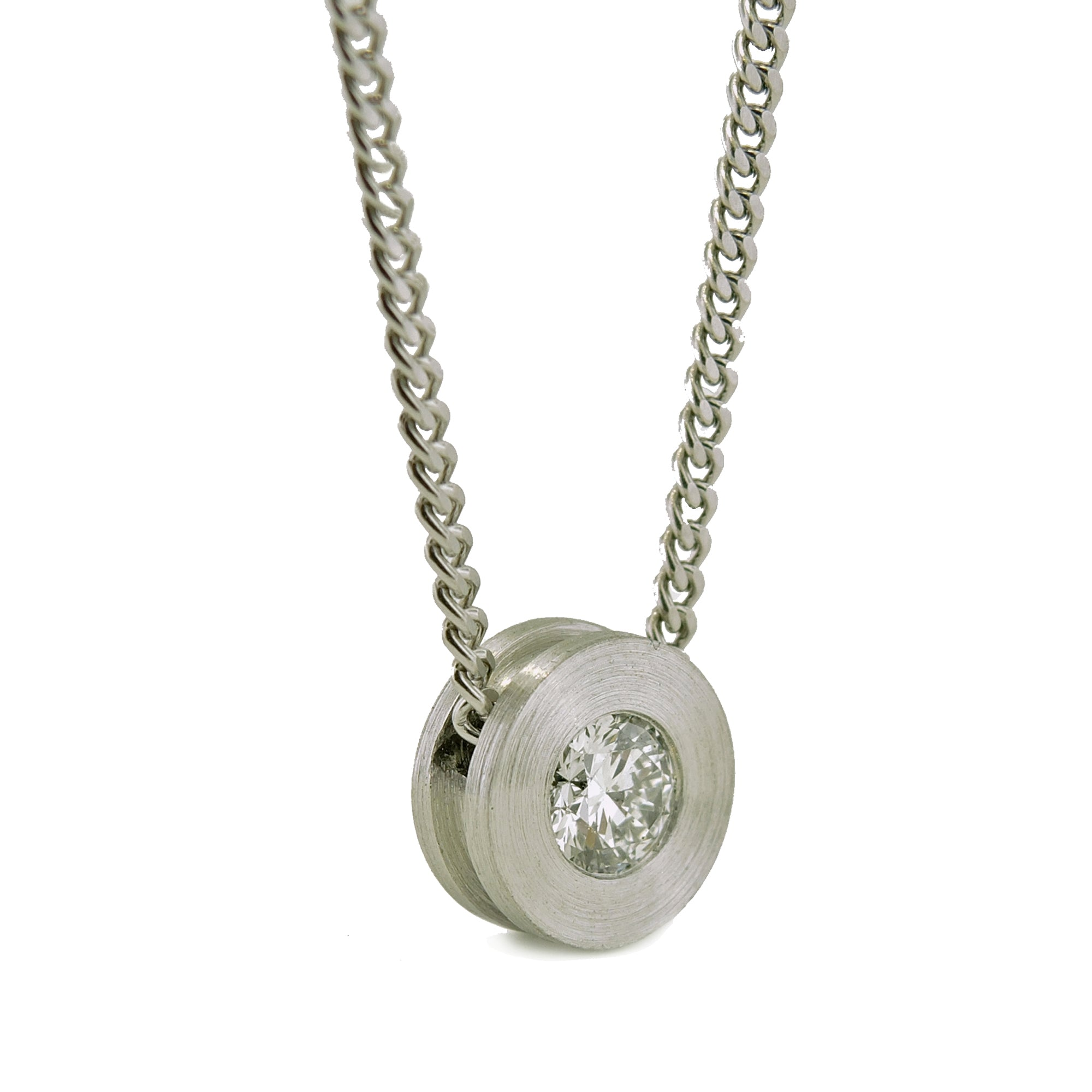 Diamond pendant: platinum with a burnish set .40ct. diamond, 9.5mm x 3.75mm deep, with slide through filed curb chain.
