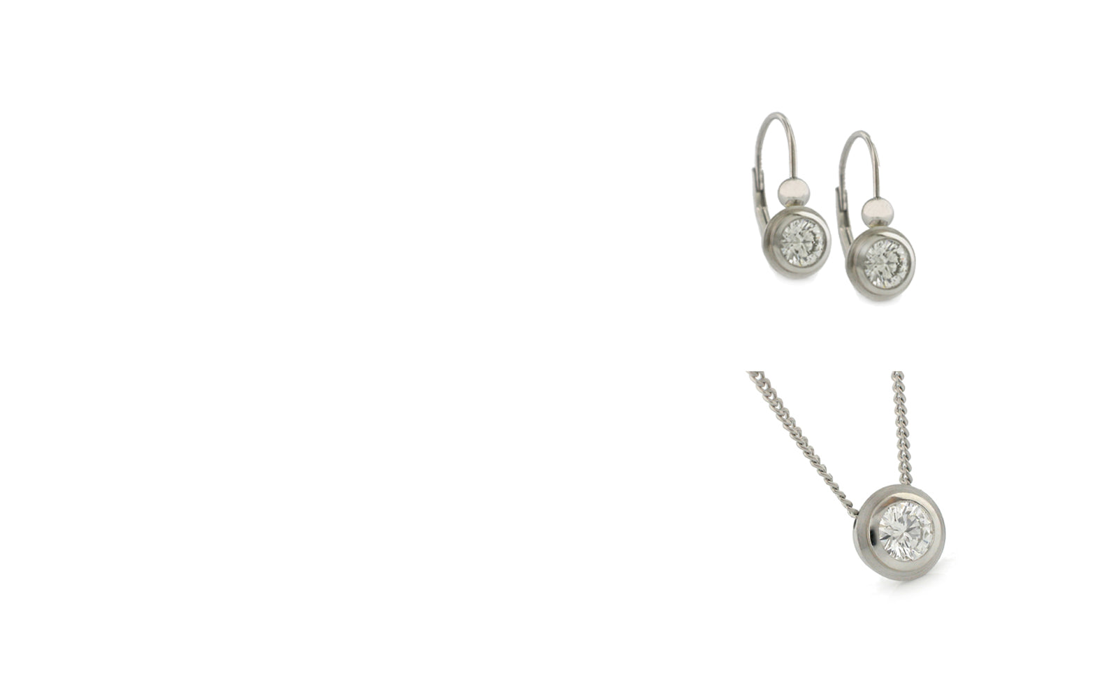 Platinum lever back earrings, in bezels, with .40tcw. of diamonds and a .25ct. matching pendant that slides on a 1 mm chain.
