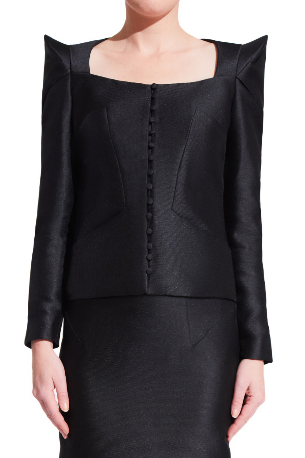 Women's black formal jacket with long sleeves and centered front buttons. Oragami style geometric design with padded shoulders