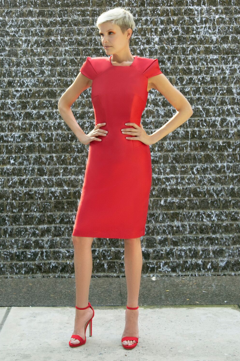 Fitted short red cocktail dress with square/trapezoid neckline and oragami style cap sleeves