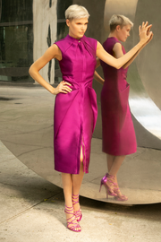 Rasberry purple sleeveless midi cocktail party dress with two-way gold zipper and adjustable front slit. The dress has a straight fit with a round high neck  and side pockets