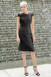 Short formal black dress with oragami style cap sleeves and square/trapezoidal shaped neckline