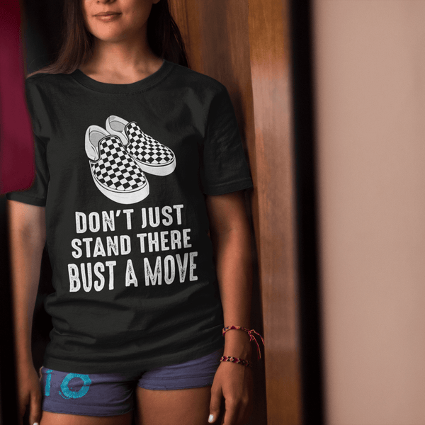 Female Standing in front of mirror wearing a Don't just stand there bust a move T-shirt from the xpert apparel store