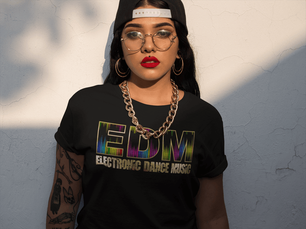 Girl with Tattoos and hat to the back  and gold chain wearing a Black T-shirt with EDM Eletronic Dance Music printed on the front, Gold textured available from the Xpert Apparel Store