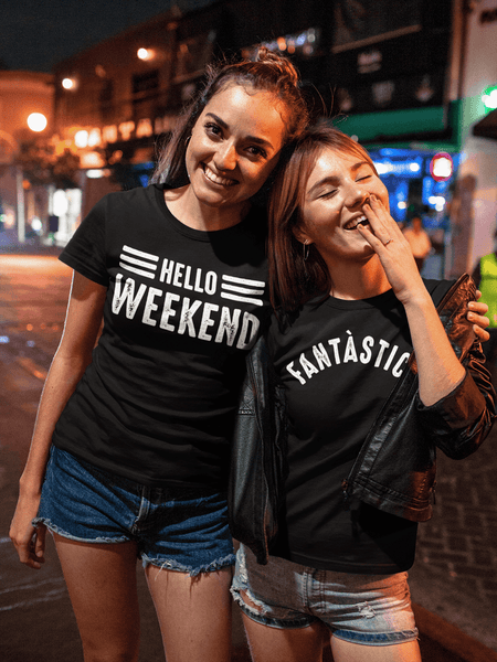 Two Teenagers out at night wearing a Hello Weekend t-shirt and the other a Fantastico design