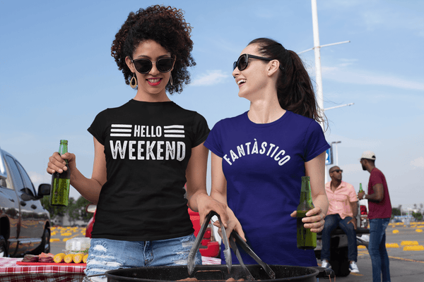 Two female friends at a tailgate party one wearing a Hello Weekend t-shirt and the other a Fantastico design