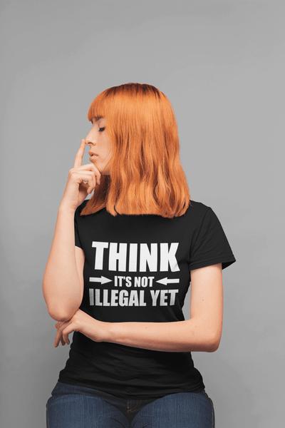 "Lady doing the Thinking Man pose, in black t-shirt with a sarcastic design ""Think It's not Illegal Yet"" design available from the Xpert Apparel Store"