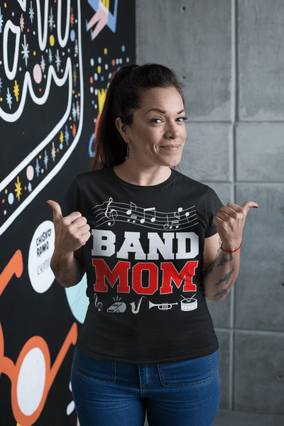 Woman wearing blue jeans and black t-shirt  with Band Mom design on the front  from the Xpert Apparel Store