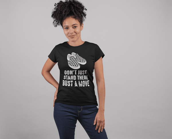 Young Lady standing with gray background wearing a Don't just stand there bust a move design from the Xpert apparel store