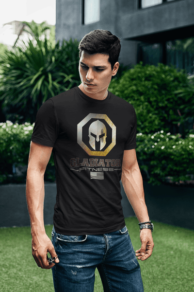 Guy in outdoor park wearing Black T-shirt with Gladiator Fitness Logo design on the front Available from the Xpert Apparel Store.
