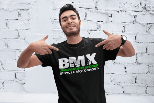 Guy wearing black BMX Bike t-shirt standing in front of white wall