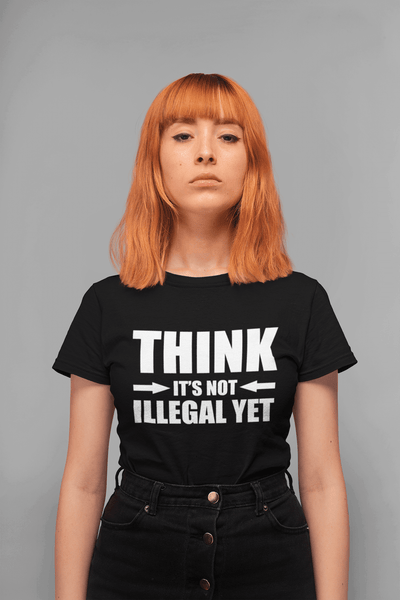 "Woman standing with gray background, red hair wearing a black T-shirt ""Think It's not Illegal Yet"" in white letters from the Xpert apparel store"
