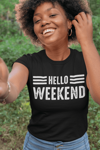 African American female smiling and posing in Black t-shirt with Hello Weekend printed in white